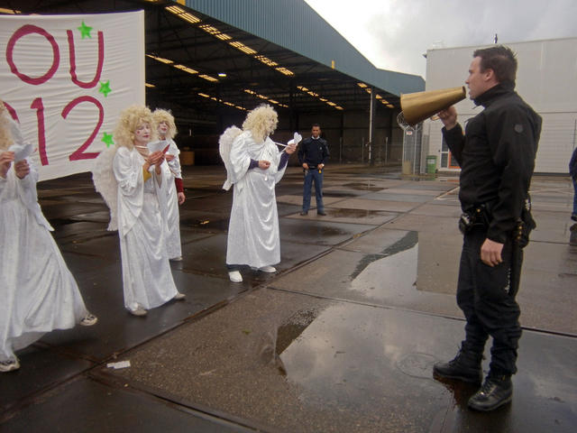 Angels without borders near Detention Centre Zaandam, December 18th 2011. Photo: Angel Kazza